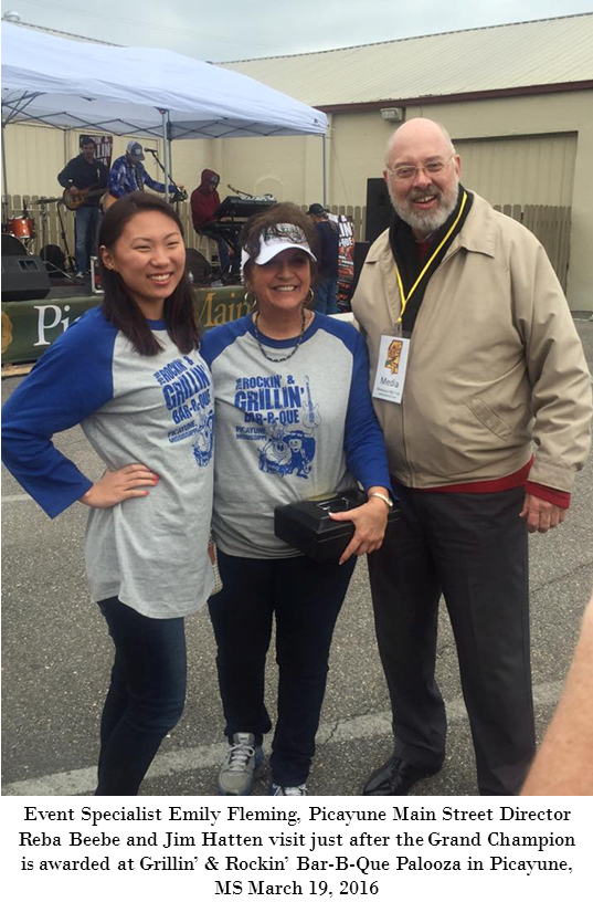 Jim Hatten with Rockin' & Grillin' Bar-B-Que Palooza Director Reba Beebe and Event Specialist Emily Fleming in Picayune, MS March 19, 2016